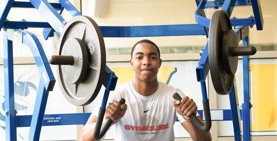 student in weight room
