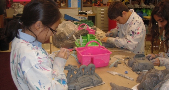 kids working on clay car designs